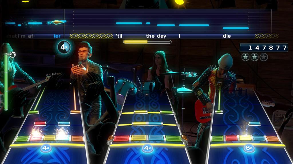 3 musicos et un chanteur, pas de doute Rock Band est bien un party game ! Dommage qu'on ne puisse pas acheter les guitares à part...
